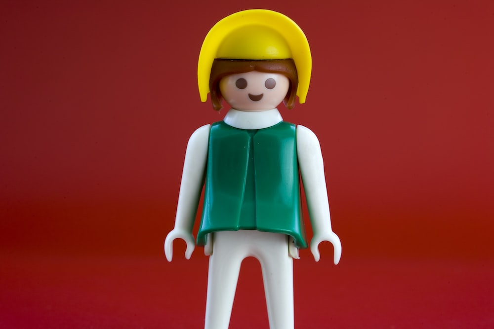 woman in green shirt and yellow hat Lego minifig