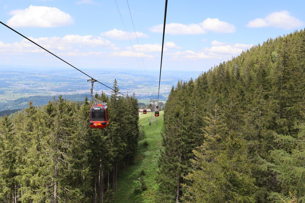 high-angle photography of red cable car