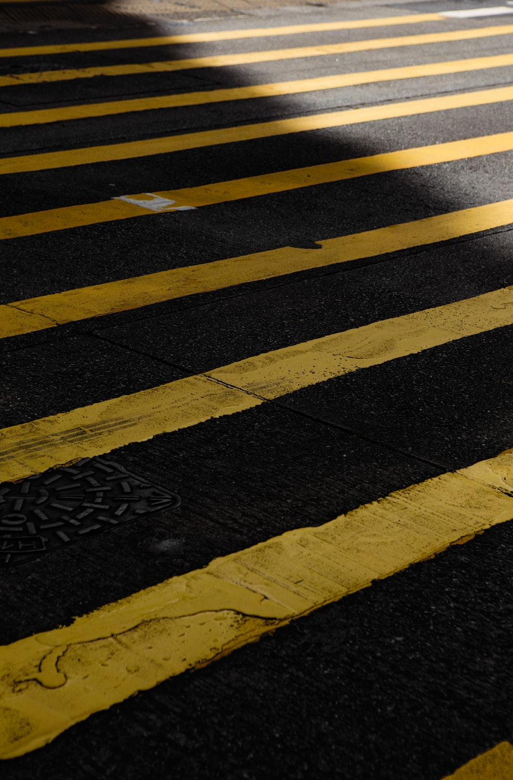 black and yellow pedestrial lane