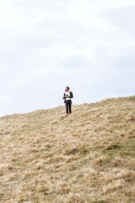 man standing in open field