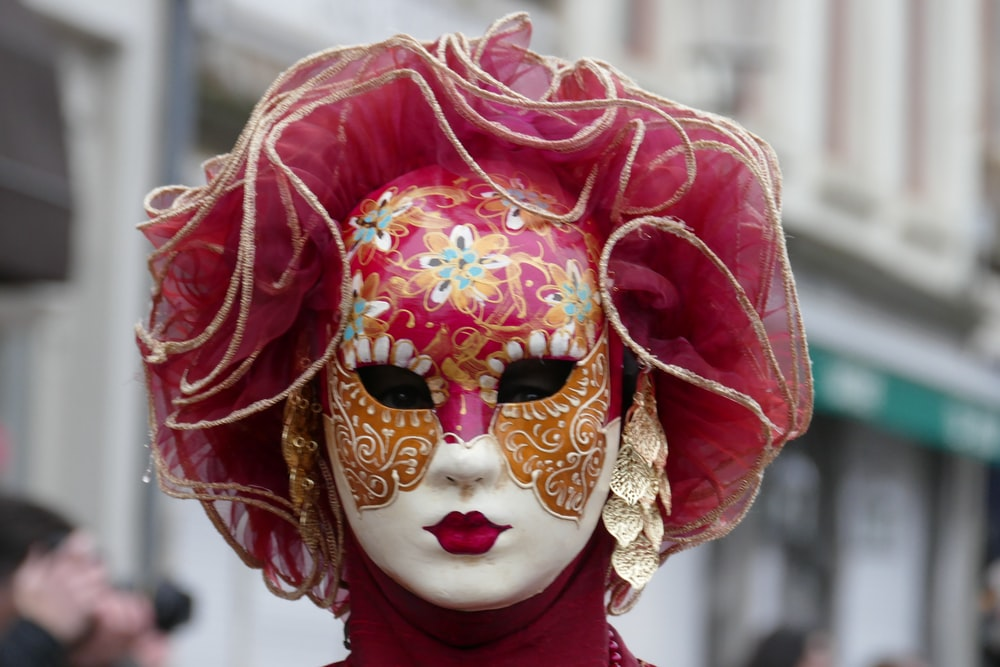 person in white and red floral mask