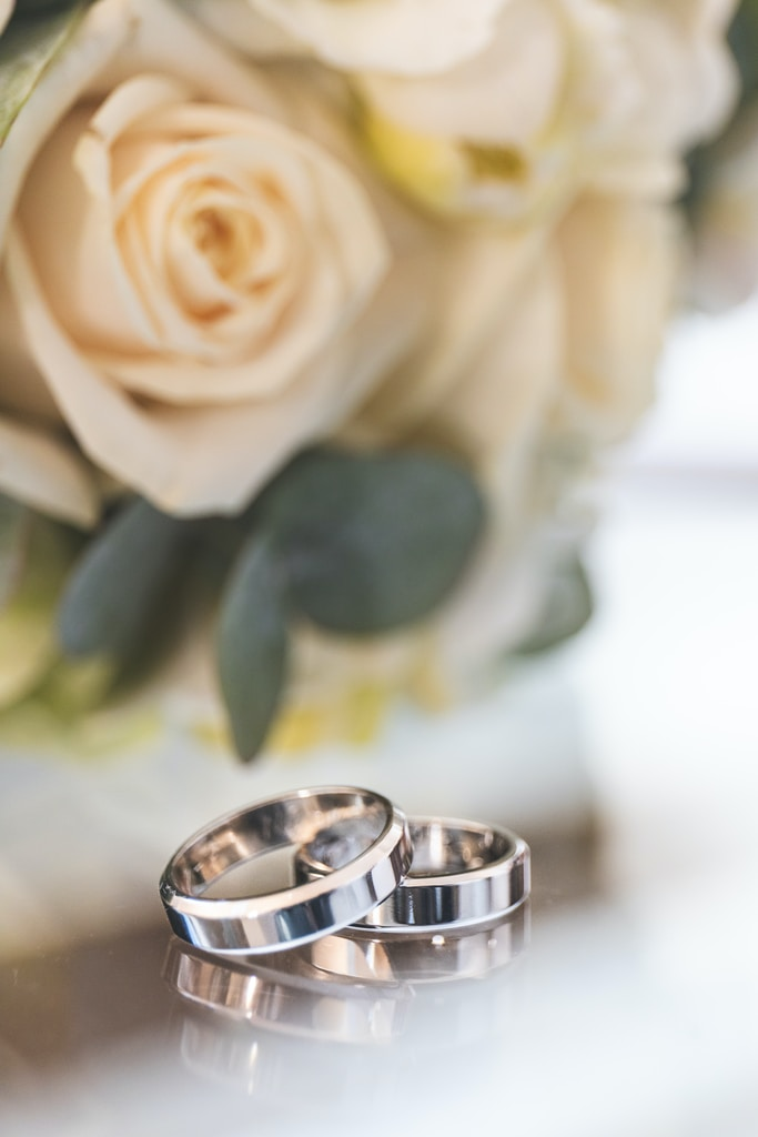 silver-colored wedding bands