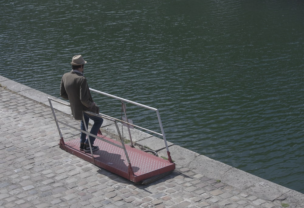 man leaning on railings