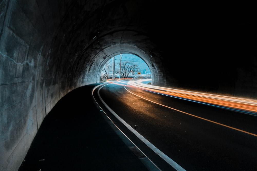 time lapse photography of cars on tunnel