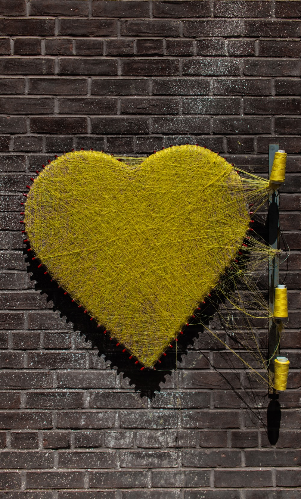 yellow thread heart wall art