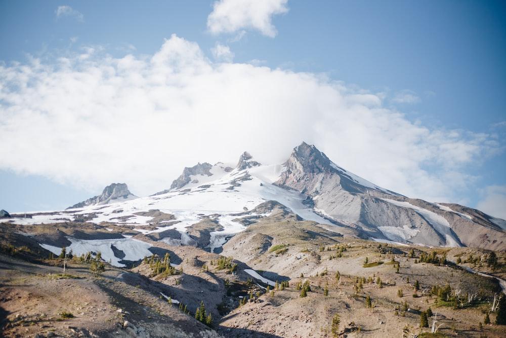 mountain range under clear blue sky