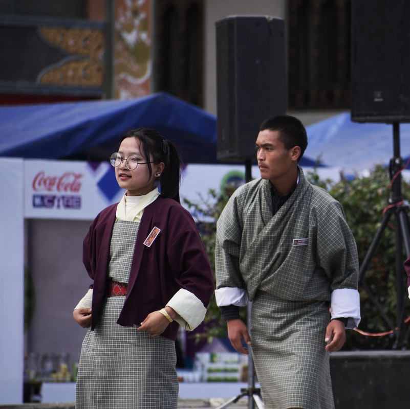 People dressed traditionally- One of the important Bhutan travel tip