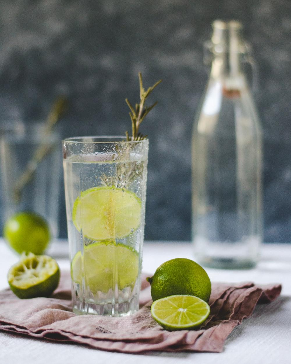 sliced lemons beside drinking glass