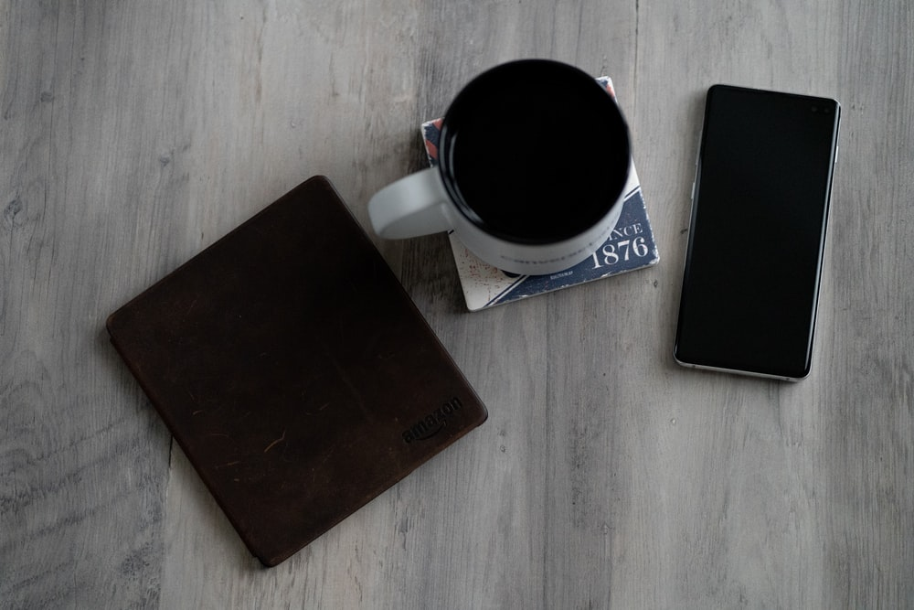 mug, wallet, and smartphone