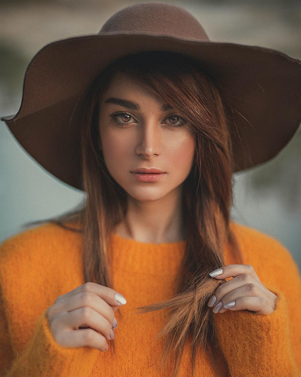 woman in orange knit sweater