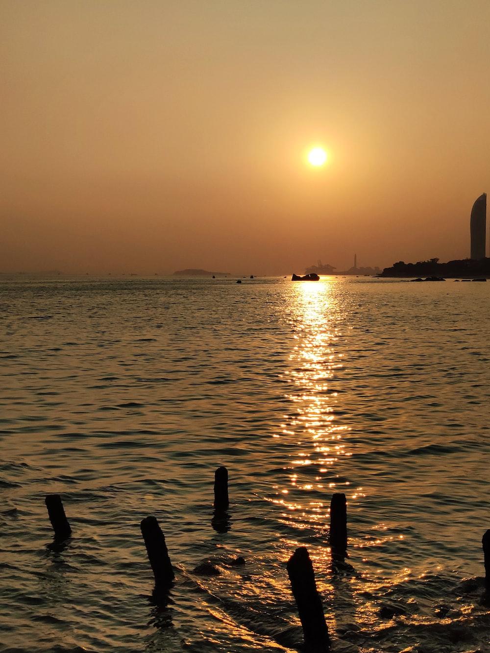boats at sea at sunset