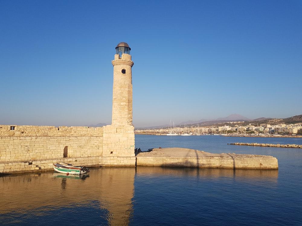 beige lighthouse under blue sky