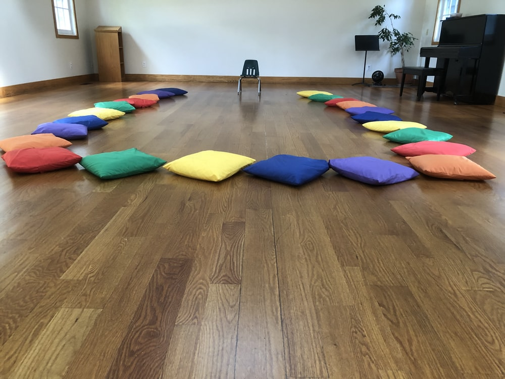 assorted-color throw pillows on the floor