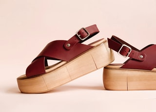 pair of maroon wedges
