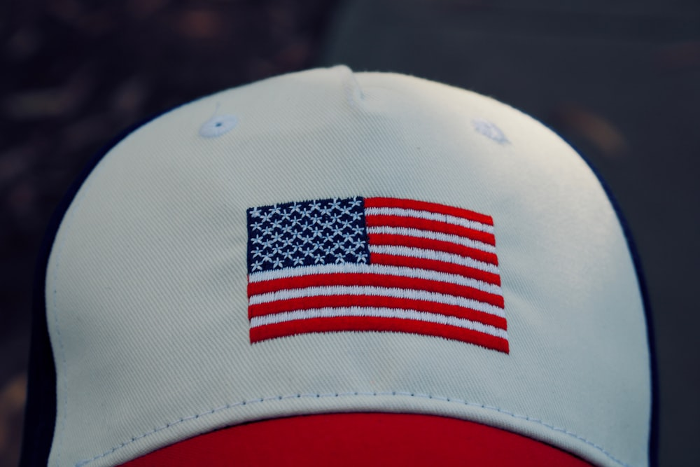 white, red, and blue fitted cap