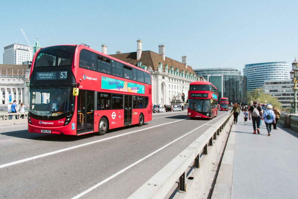 red buses on road