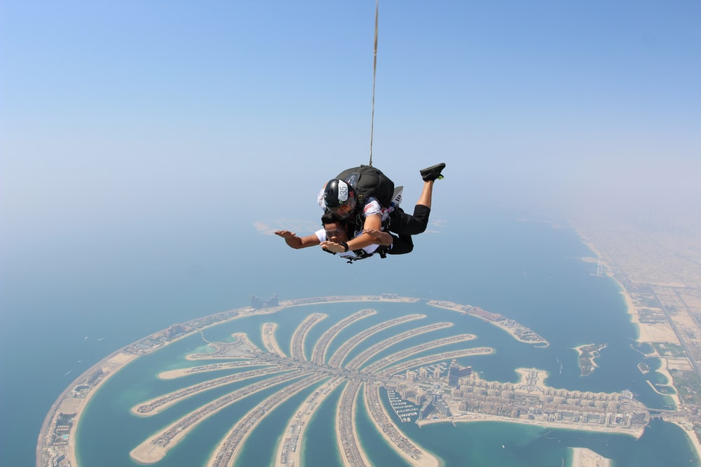 two people skydiving over Dubai