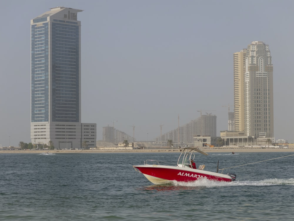 white and red speedboat