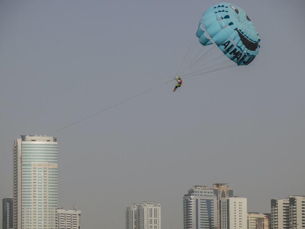 photography of man doing parachute during daytime