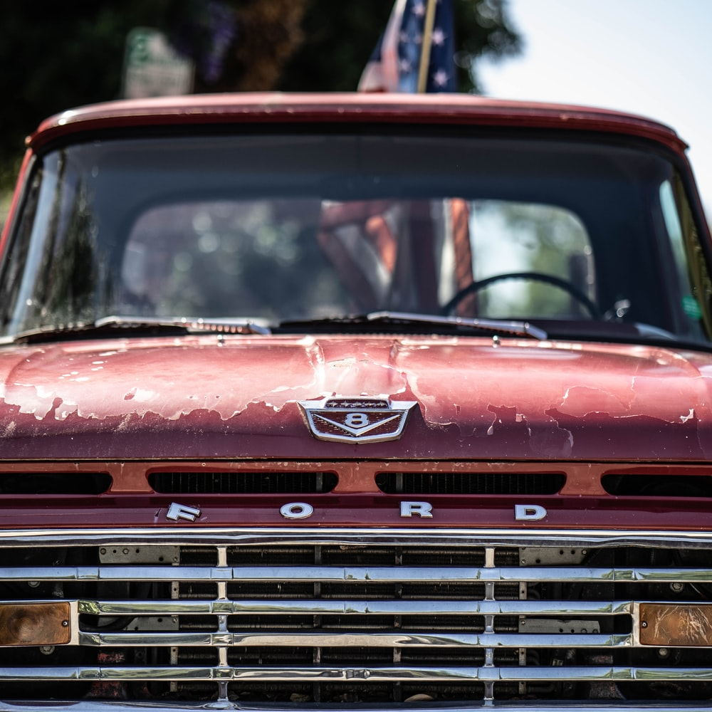 red Ford vehicle
