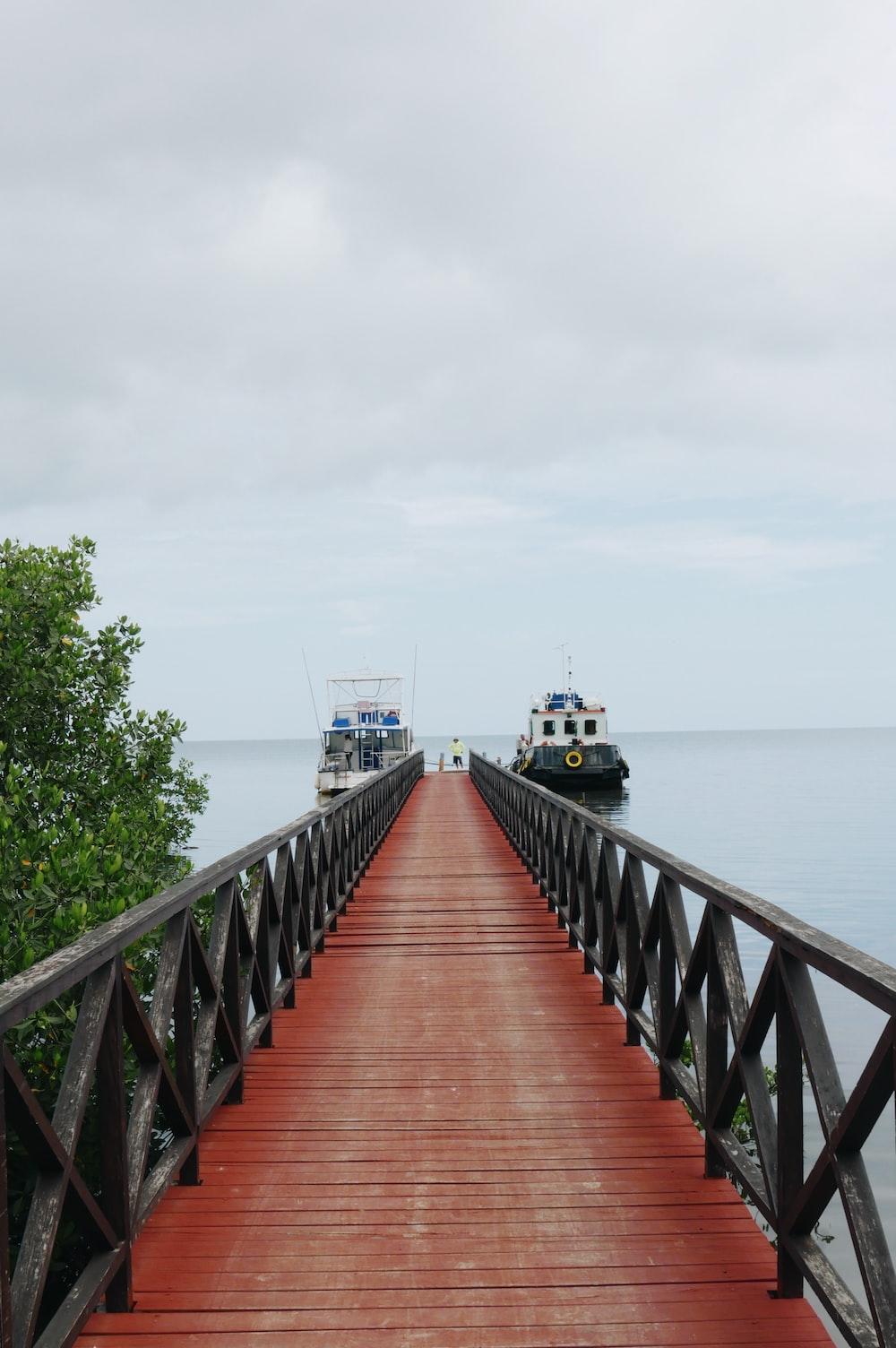 black and maroon dock towards ships