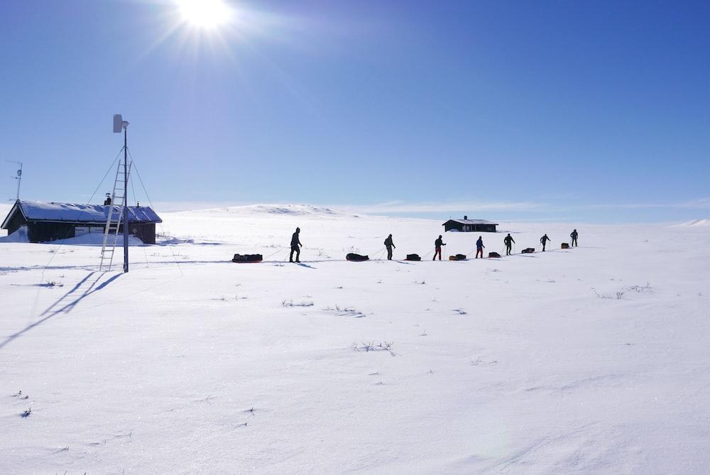 people on snowfield during daytiem