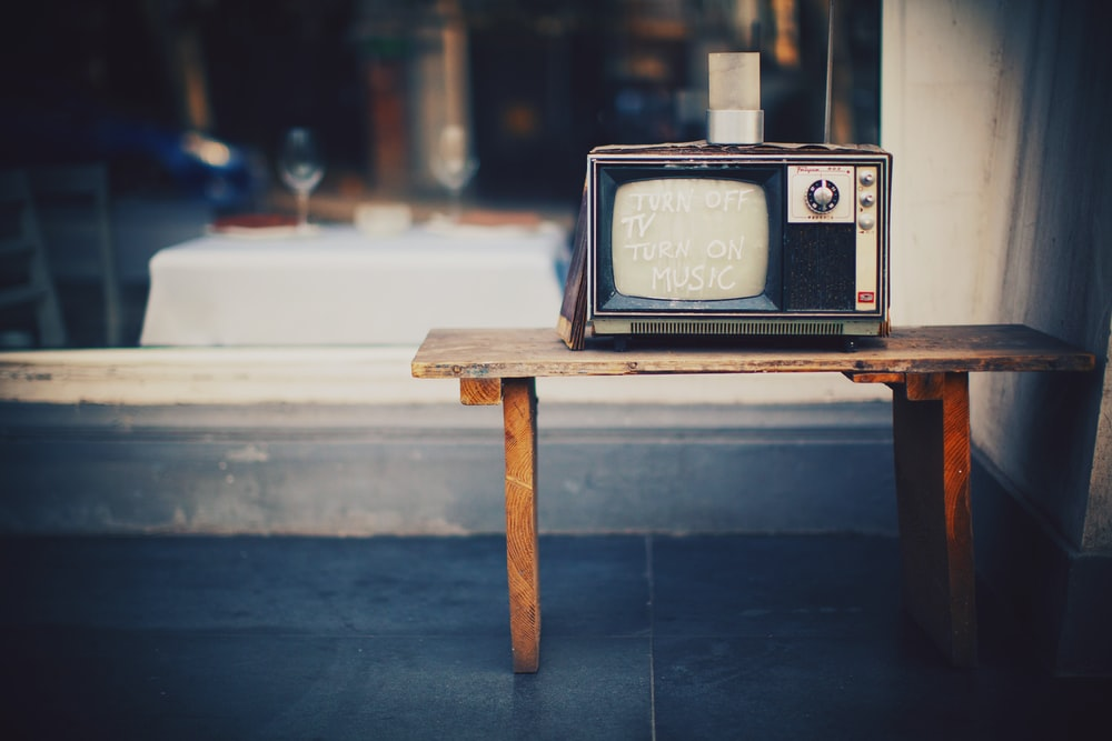 classic CRT TV on wooden bench
