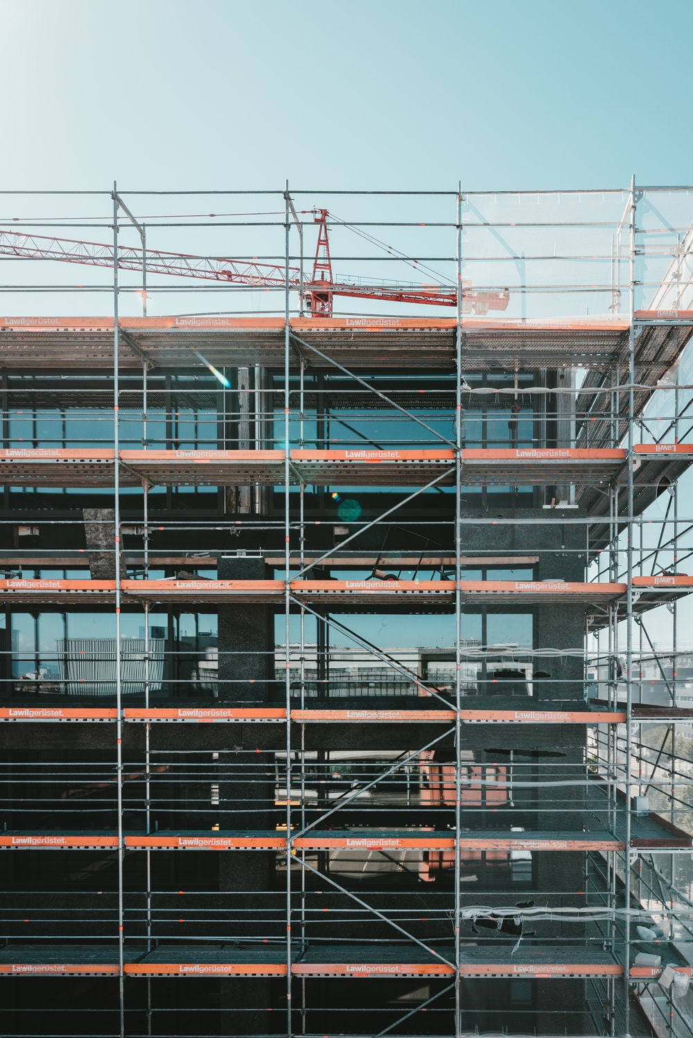 scaffolding near brown and beige building