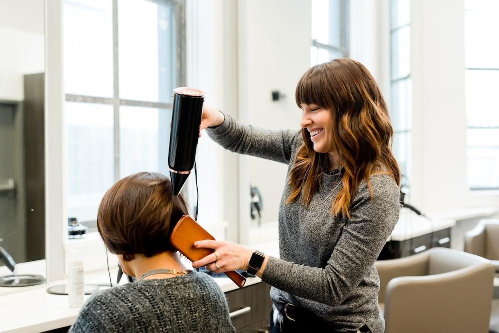 woman holding hair dryer