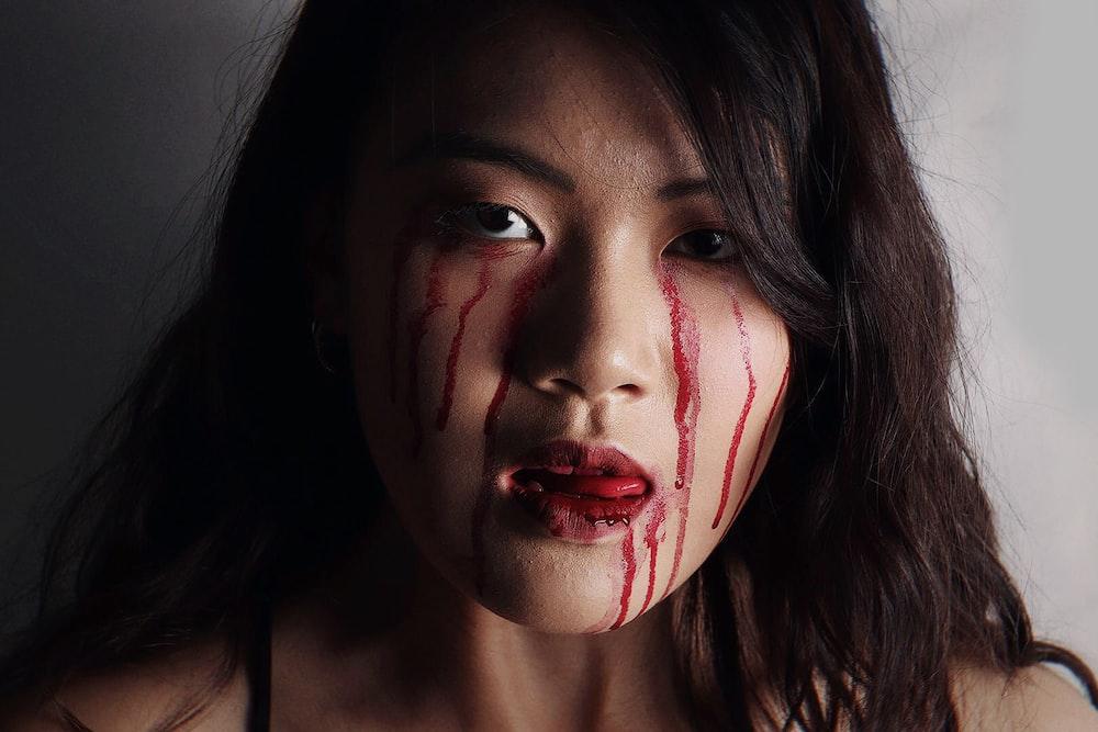 woman wearing blood makeup