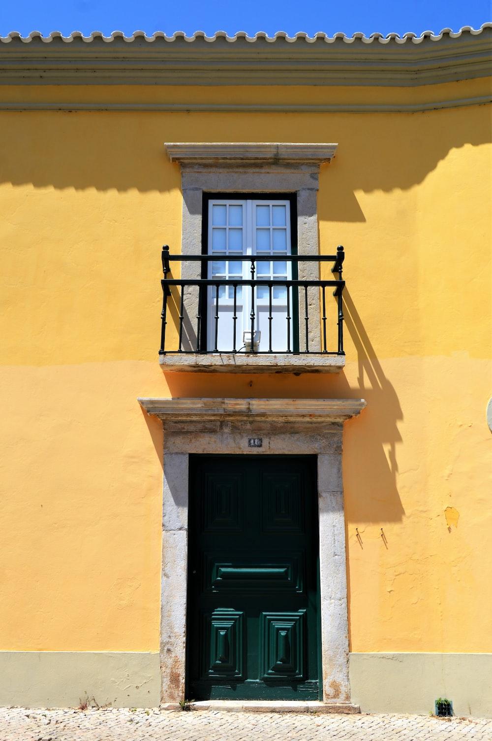 yellow concrete house