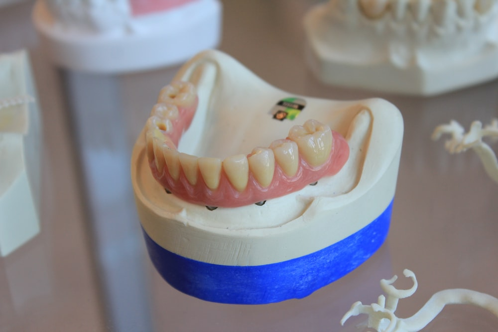 dentures on white scale rack