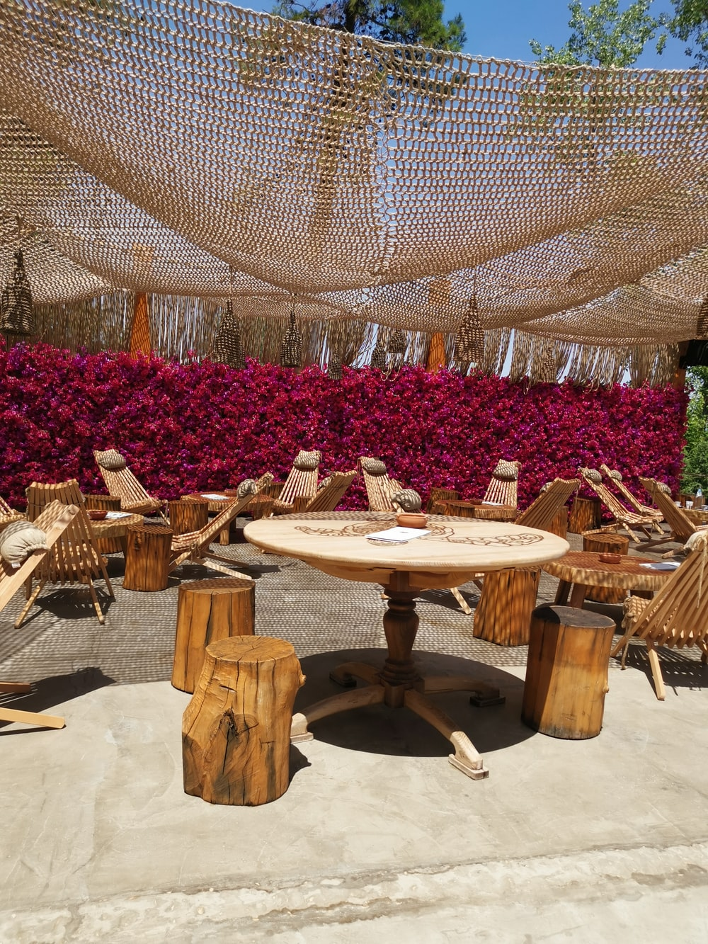 empty wooden chairs and tables outside during daytime