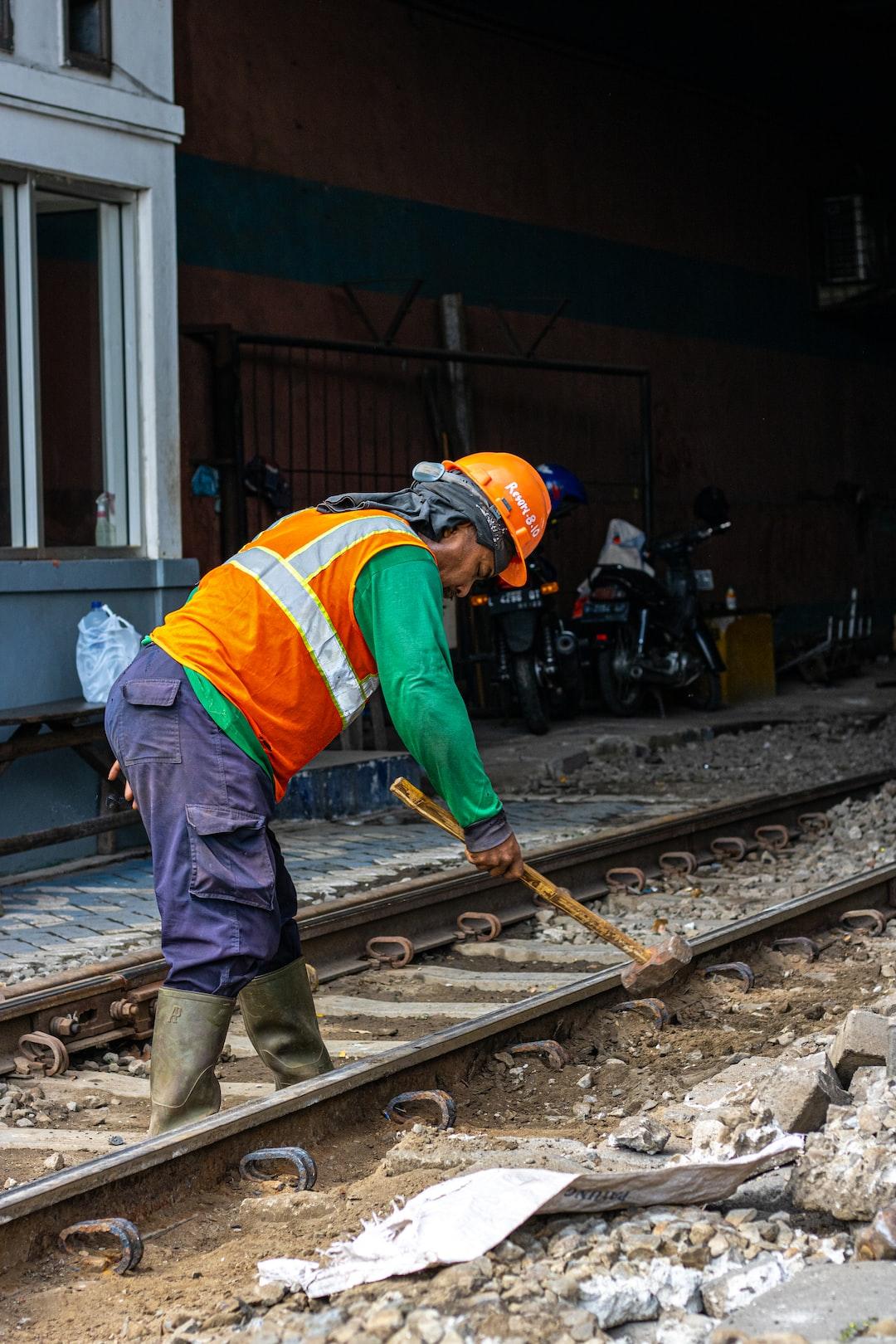 worker fixing a train road in jalan Dupak Surabaya Indonesia