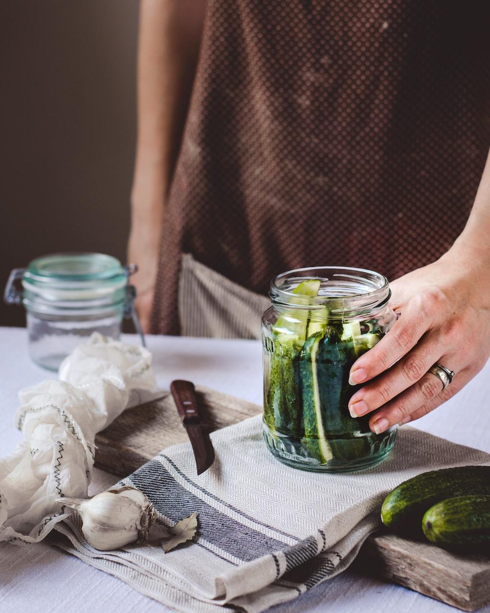 pickle jar on white textile