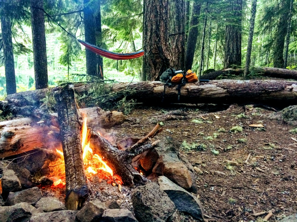 red hammock near bonfire