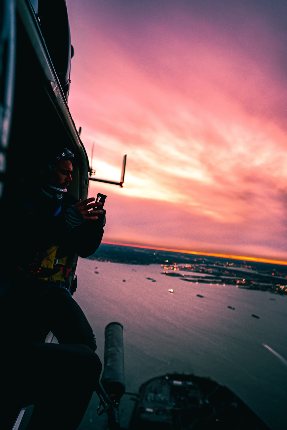 man in helicopter taking photo