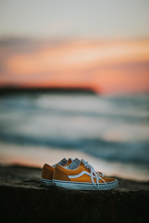 pair of yellow Vans Old Skool low-top sneakers