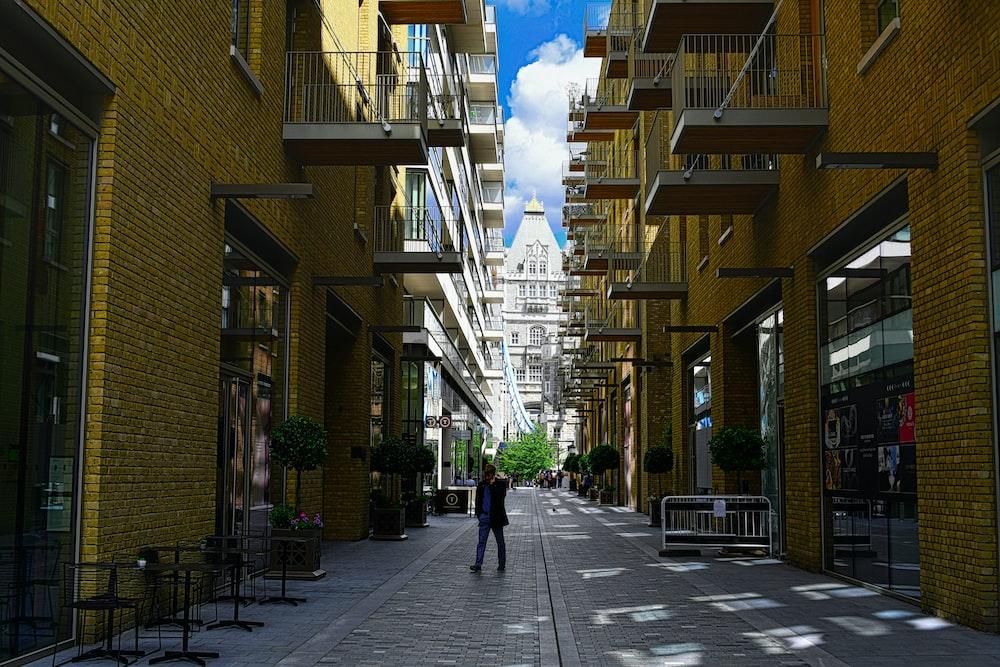 person standing between buildings
