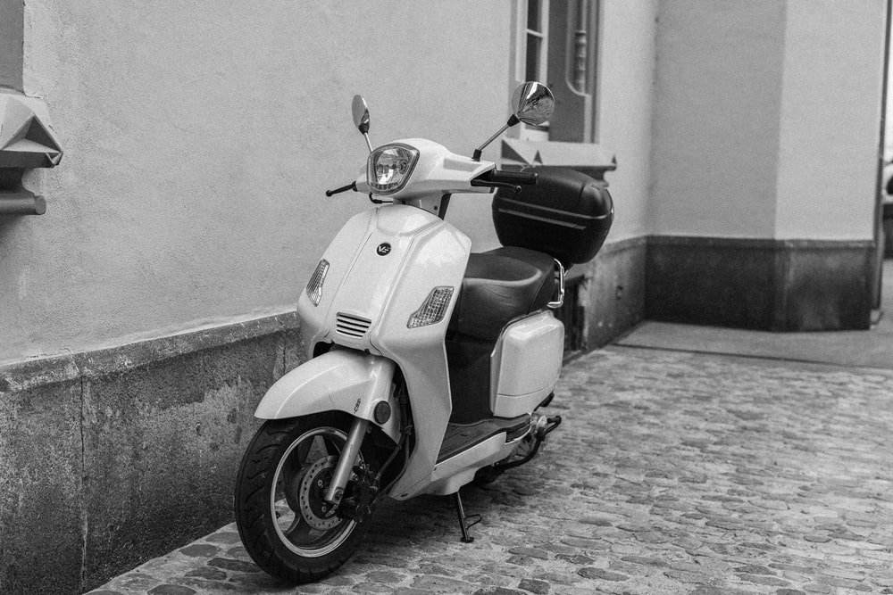 motor scooter with top box near wall