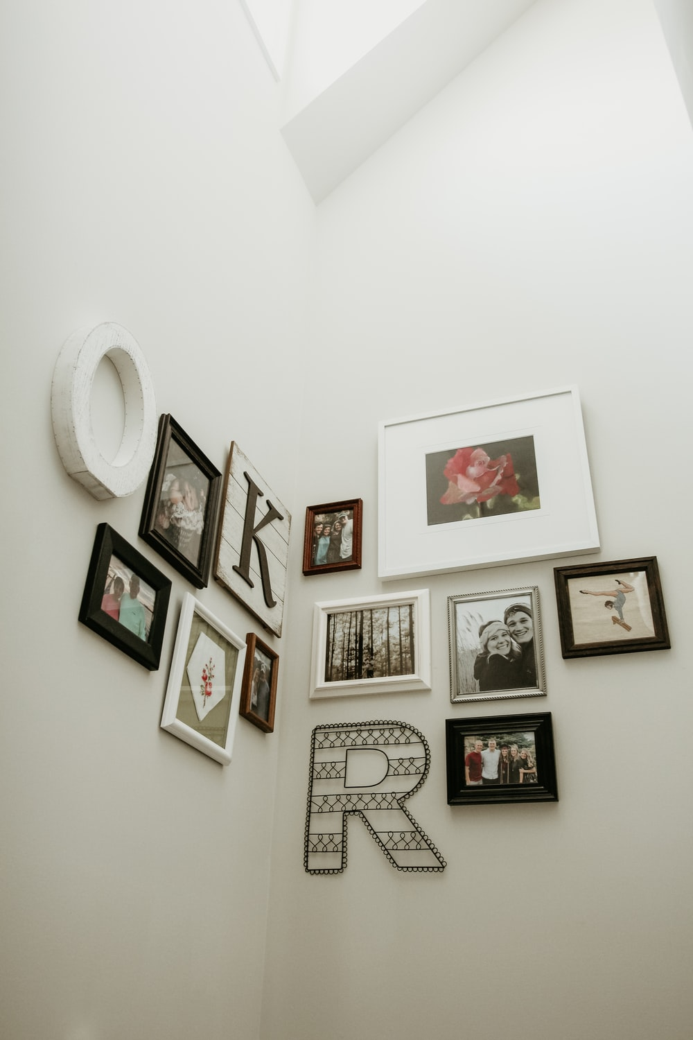 white and black photo frames hanging on wall