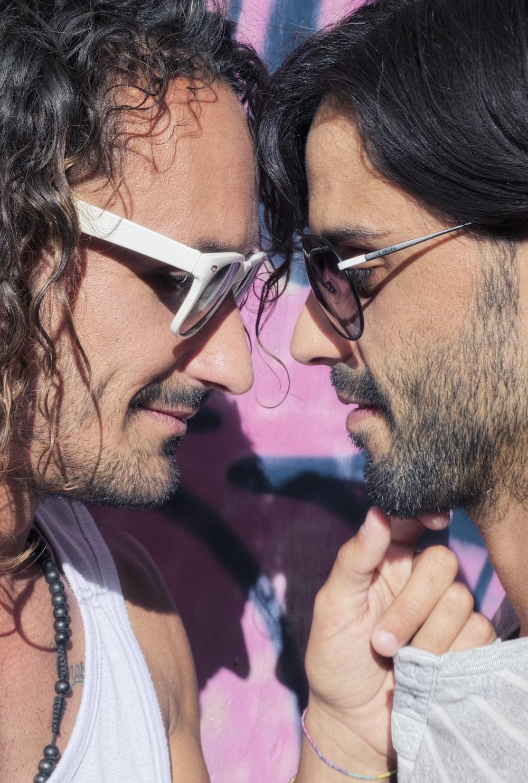 two men wearing sunglasses
