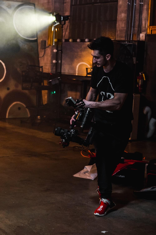man carrying camera