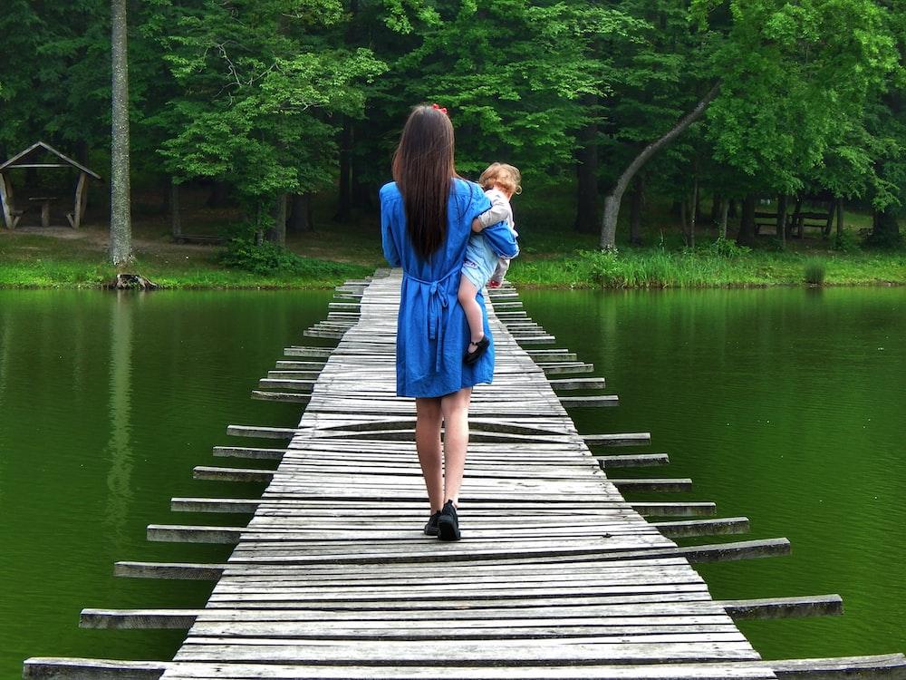 woman walking on brown dock