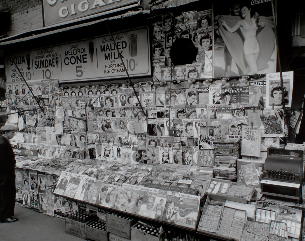 grayscale photo of magazines