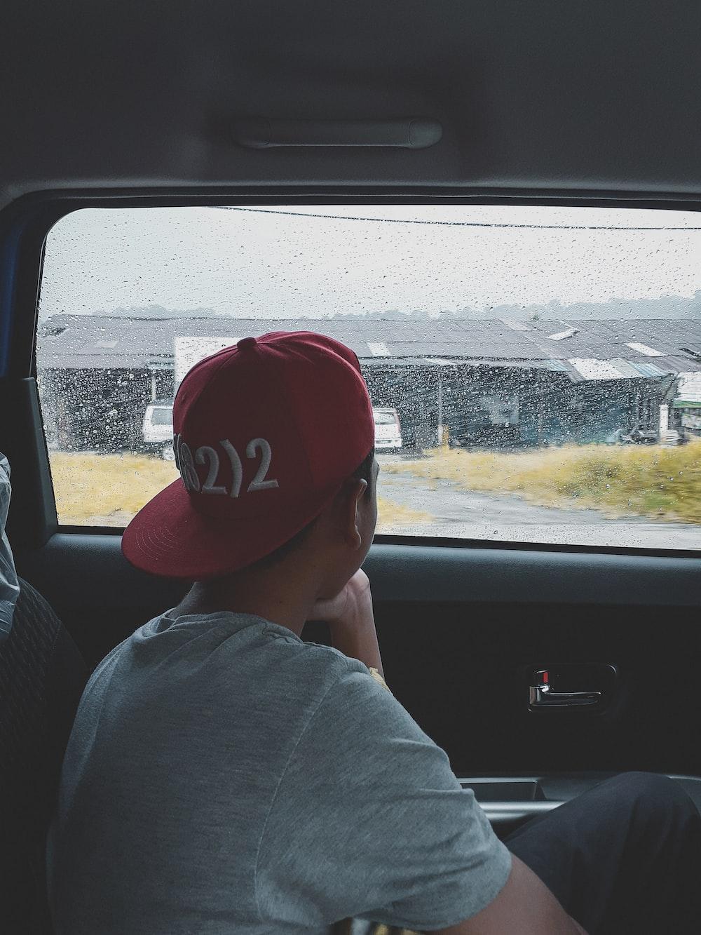 man wearing red cap