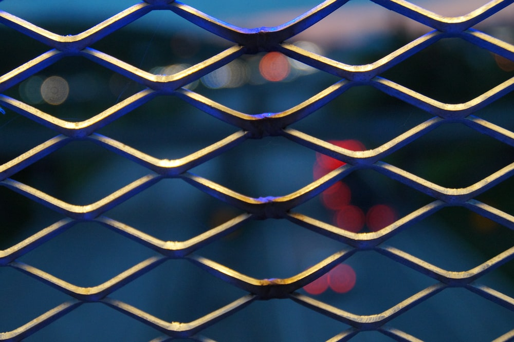 gray metal mesh fence