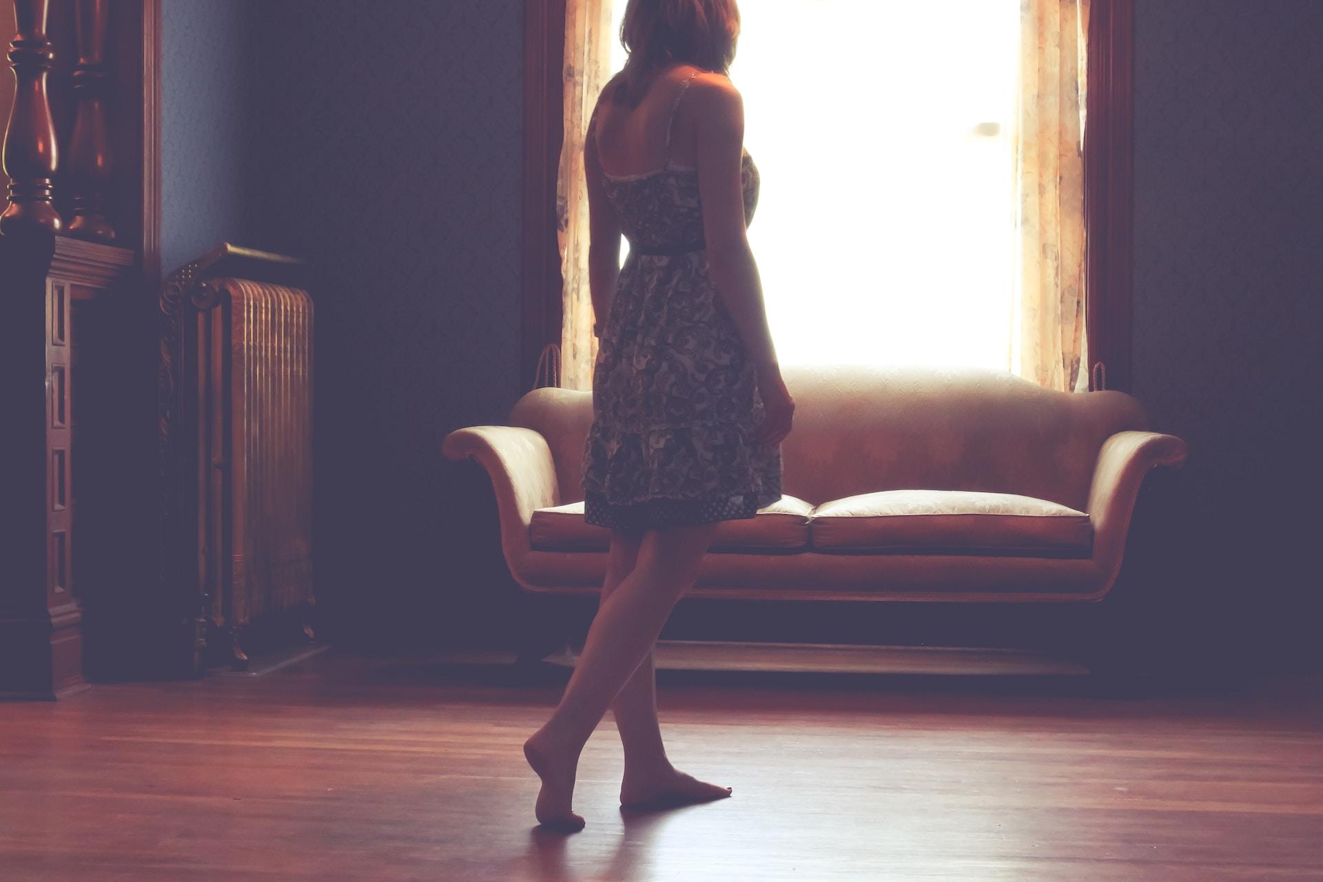 woman standing inside living room