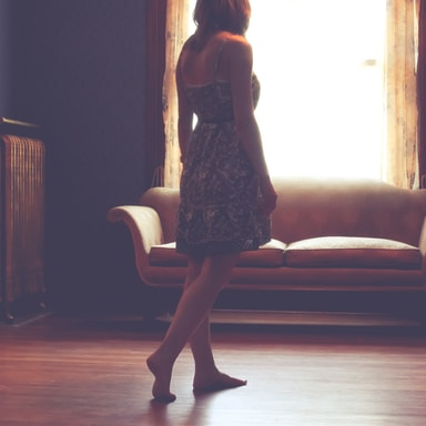 woman standing inside living room