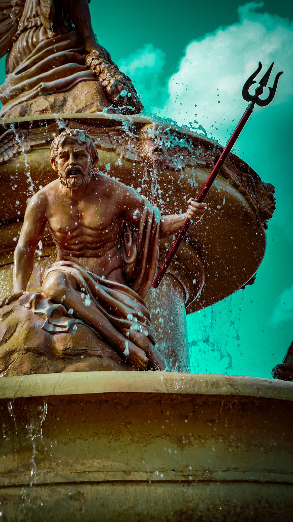 man with trident statue water fountain